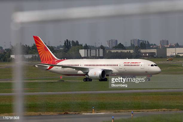 A Boeing Co 787 Dreamliner aircraft operated by Air India Ltd lands on the runway on the first day of the Paris Air Show in Paris France on Monday...