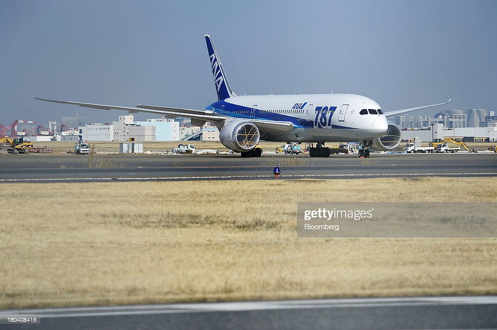 A Boeing Co. 787 Dreamliner aircraft operated by All Nippon Airways Co. (ANA) stands with its engines covered at Haneda Airport in Tokyo, Japan, on Wednesday, Jan. 30, 2013. ANA has canceled a total of 784 flights, affecting 74,200 passengers through Feb. 12, since a Jan. 16 incident that led to the global grounding of Boeing Co. 787s, according to figures from the company. Photographer: Akio Kon/Bloomberg via Getty Images
