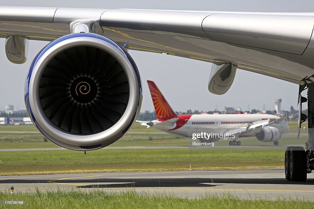 A Boeing Co. 787 Dreamliner aircraft passes behind the engine of a Airbus SAS A380 aircraft after landing on the first day of the Paris Air Show in Paris, France, on Monday, June 17, 2013. The 50th International Paris Air Show is the world's largest aviation and space industry show, and takes place at Le Bourget airport June 17-23. Photographer: Chris Ratcliffe/Bloomberg via Getty Images