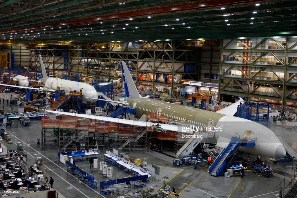 Boeing Co. 787 jets are sit on the production line at Boeing's manufacturing facility in Everett, Washington, U.S., on Wednesday, Feb. 3, 2010. Boeing Co. is poised to fly the first 787 Dreamliner fitted with passenger seats, mood lights, arches and dimming windows that have been one of the jet's biggest selling points, even after more than two years of delays. Photographer: Kevin P. Casey/Bloomberg via Getty Images