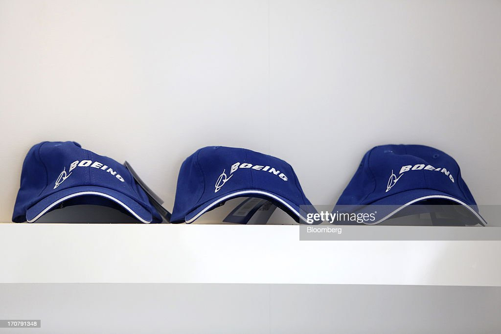 Boeing Co. caps sit on display in the company's chalet on the first day of the Paris Air Show in Paris, France, on Monday, June 17, 2013. The 50th International Paris Air Show is the world's largest aviation and space industry show, and takes place at Le Bourget airport June 17-23. Photographer: Chris Ratcliffe/Bloomberg via Getty Images