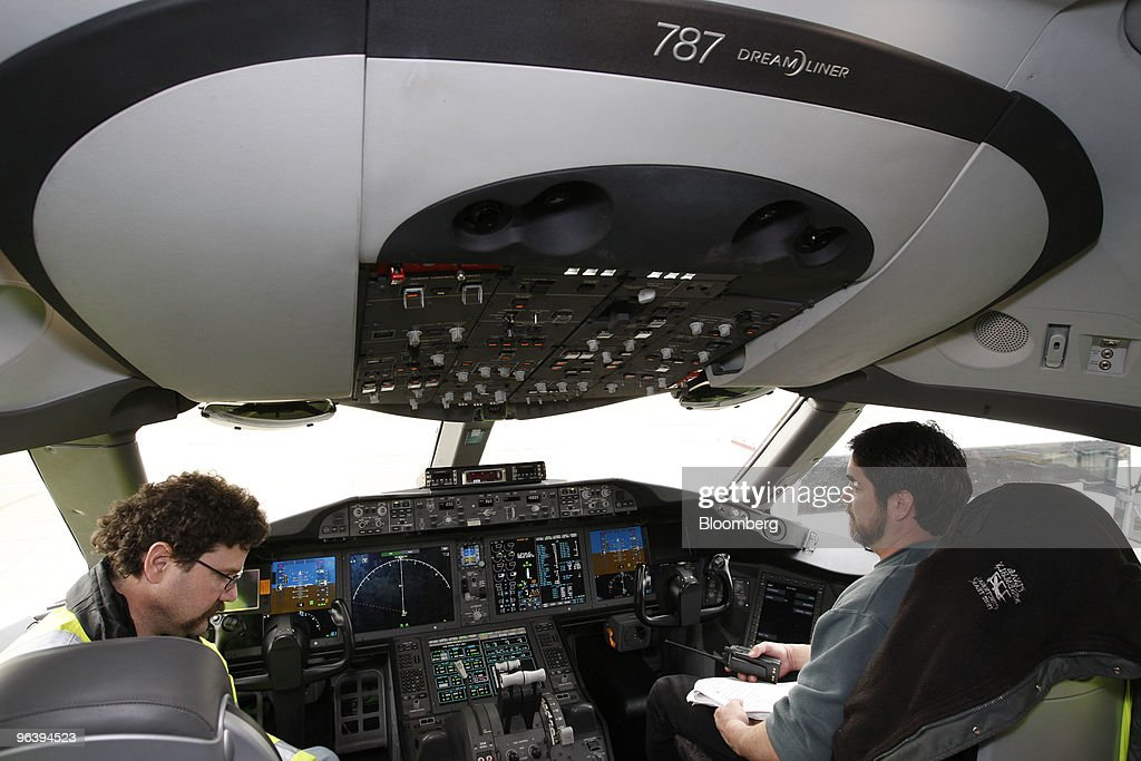 Boeing Co. employees check the cockpit of a 787 jet at Boeing's manufacturing facility in Everett, Washington, U.S., on Wednesday, Feb. 3, 2010. Boeing Co. is poised to fly the first 787 Dreamliner fitted with passenger seats, mood lights, arches and dimming windows that have been one of the jet's biggest selling points, even after more than two years of delays. Photographer: Kevin P. Casey/Bloomberg via Getty Images