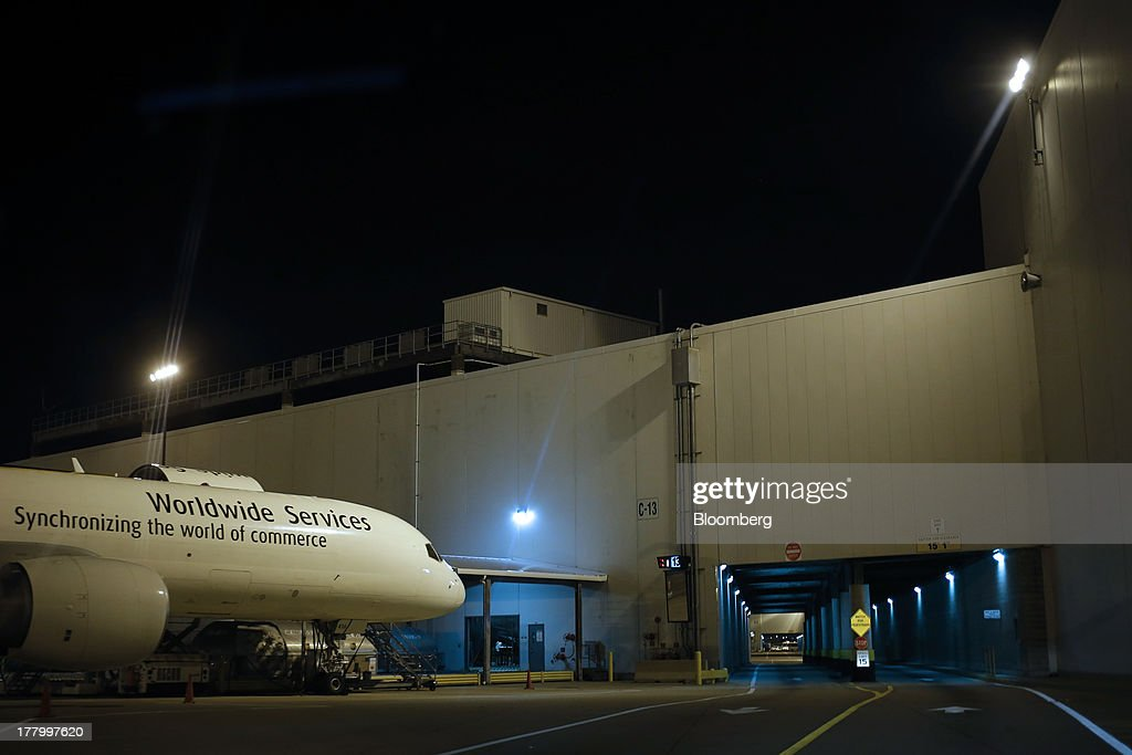 A Boeing Co. freighter waits to be unloaded during United Parcel Service Inc. (UPS) Worldport overnight shipping operations at Louisville International Airport in Louisville, Kentucky, U.S., on Thursday, Aug. 22, 2013. Founded 106 years ago as a bicycle messenger service, UPS now handles 16.3 million packages and documents per day and is considered an economic bellwether because of the diverse items it delivers such as industrial parts, health-care products and financial paperwork. Photographer: Luke Sharrett/Bloomberg via Getty Images