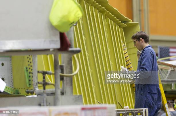 Boeing employee works on the wing of a Boeing 777 jet June 13 2012 at the Boeing Factory in Everett Washington