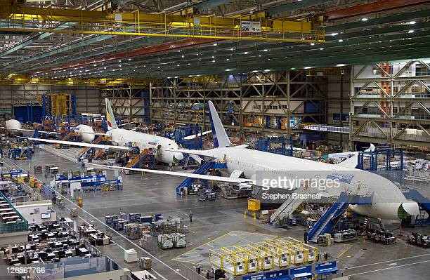 Boeing employees assemble Boeing 787 Dreamliners September 25 2011 in Everett Washington Boeing delivered its longawaited and delayed first 787...