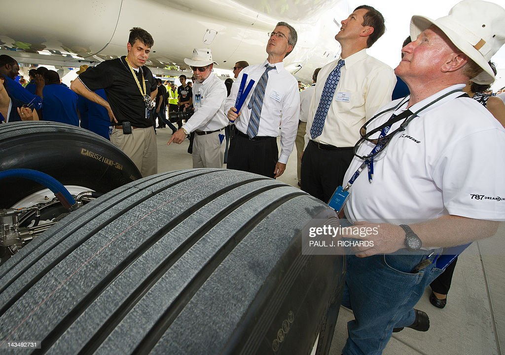 Boeing employees look over the landing gear area on the new Boeing 787 Dreamliner built for Air India after it was rolled off the production line at Boeing's new production facilities April 27, 2012, in North Charlston, South Carolina. The plane marks Boeing's first South Carolina made 787 Dreamliner aircraft. AFP PHOTO/Paul J. Richards