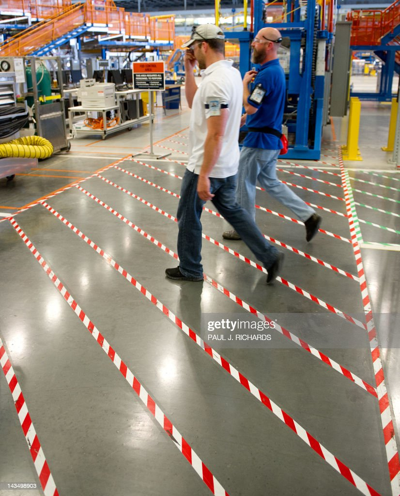 Boeing employees walk the floor of Boeing's new production facilities April 27, 2012, in North Charlston, South Carolina. Boeing rolled-off it's first South Carolina made 787 Dreamliner aircraft here today. AFP PHOTO/Paul J. Richards