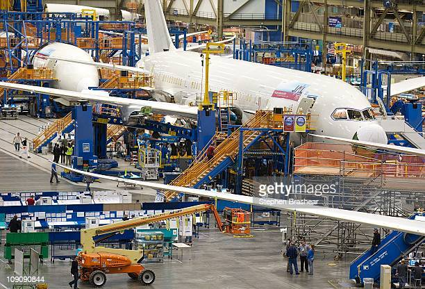 Boeing employees work on a Boeing 787 Dreamliner on one of the assembly lines February 14 2011 at the company's factory in Everett Washington The new...