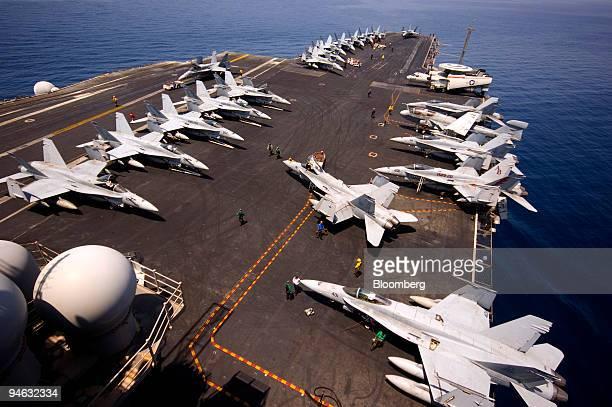 Boeing F/A18 Hornet is pushed into its parking space on the American aircraft carrier USS Enterprise on Saturday Aug 25 2007 The USS Enterprise is in...
