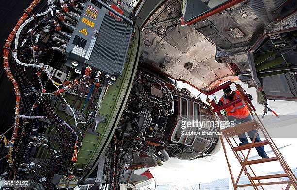 Boeing flight line mechanic Mike Feeney work on an engine of a Boeing 7478 freighter February 8 2009 at Paine Field in Everett Washington The 7478 is...