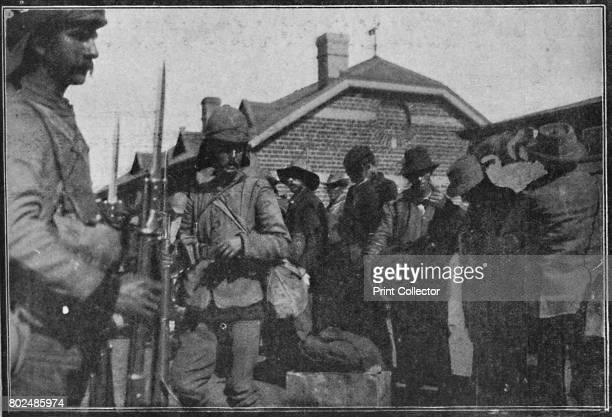 Boer Prisoners at Vereeniging They Are Looking Wistfully at Tommy's CheeseKnife Commonly Known as a Bayonet' 1900 From Black White Budget Vol III...