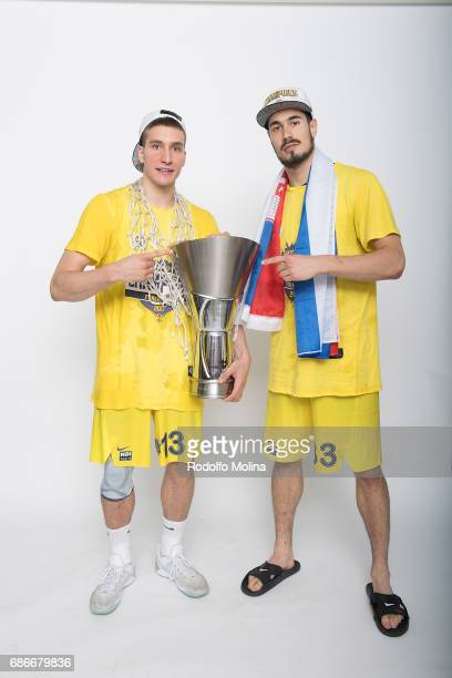 Bogdan Bogdanovic #13 of Fenerbahce Istanbul and Nikola KalinicÊ#33 pose with Trophy during Turkish Airlines EuroLeague Basketball Final Four...