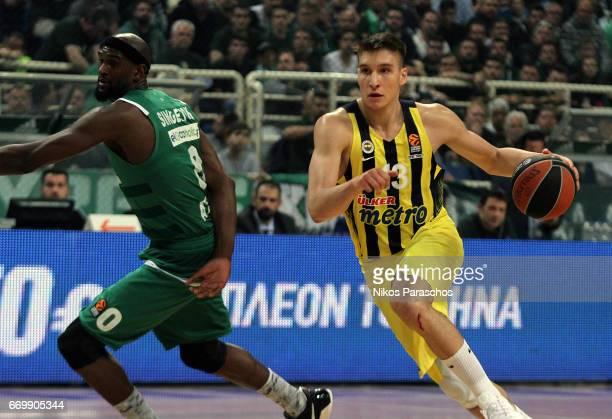 Bogdan Bogdanovic #13 of Fenerbahce Istanbul competes with Chris Singleton #0 of Panathinaikos Superfoods Athens during the 2016/2017 Turkish...