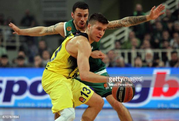 Bogdan Bogdanovic #13 of Fenerbahce Istanbul competes with Mike James #5 of Panathinaikos Superfoods Athens during the 2016/2017 Turkish Airlines...
