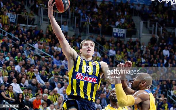Bogdan Bogdanovic #13 of Fenerbahce Ulker Istanbul in action during the 20142015 Turkish Airlines Euroleague Basketball Play Off Game 1 between...