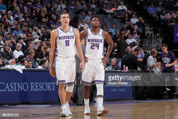 Bogdan Bogdanovic and Buddy Hield of the Sacramento Kings look on during the game against the San Antonio Spurs on October 2 2017 at Golden 1 Center...