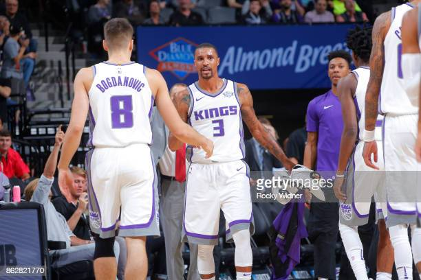 Bogdan Bogdanovic and George Hill of the Sacramento Kings high five during the game against the San Antonio Spurs on October 2 2017 at Golden 1...
