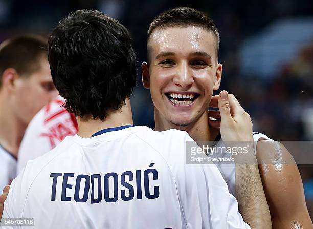 Bogdan Bogdanovic and Milos Teodosic of Serbia celebrate victory after the 2016 FIBA World Olympic Qualifying basketball Final match between Serbia...