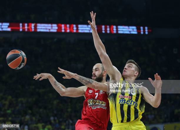 Bogdan Bogdanovic of Fenerbahce in action against Vassilis Spanoulis of Olympiacos during the Turkish Airlines Euroleague Final Four basketball final...