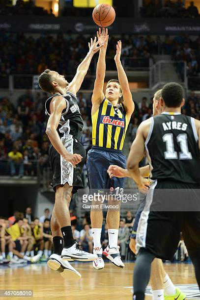 Bogdan Bogdanovic of Fenerbahce Ulker shoots against Kyle Anderson during the game as part of the NBA Global Games on October 11 2014 at the Ulker...