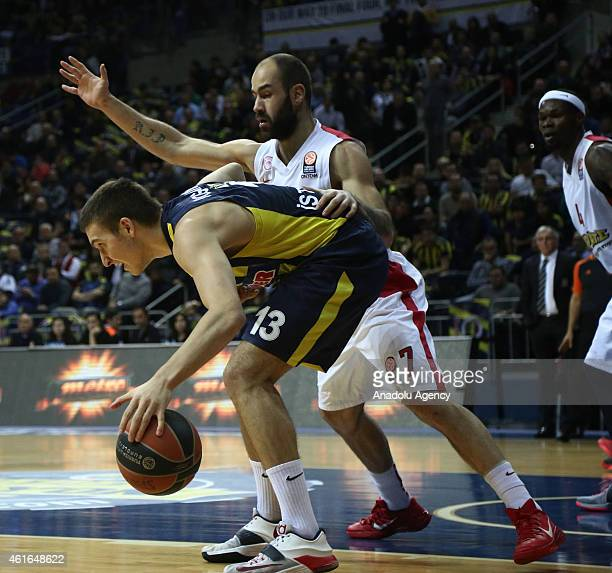 Bogdan Bogdanovic of Fenerbahce Ulker vies with Vassilis Spanoulis of Olympiacos during the Turkish Airlines Euroleague Top 16 basketball match...