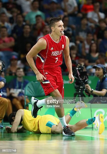 Bogdan Bogdanovic of Serbia celebrates after scoring against Australia during the Men's Semifinal match on Day 14 of the Rio 2016 Olympic Games at...