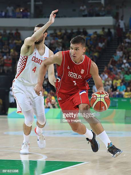 Bogdan Bogdanovic of Serbia drives against Luka Babic of Croatia during a quarterfinal match on August 17 2016 in Rio de Janeiro Brazil