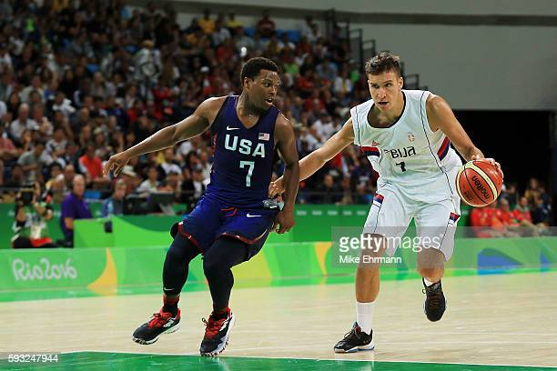 Bogdan Bogdanovic of Serbia drives the ball around Kyle Lowry of United States during the Men's Gold medal game on Day 16 of the Rio 2016 Olympic...
