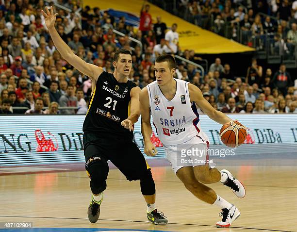 Bogdan Bogdanovic of Serbia drives to the basket against Paul Zipser of Germany during the FIBA EuroBasket 2015 Group B basketball match between...