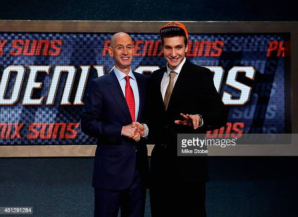 Bogdan Bogdanovic of Serbia shakes hands with NBA Commissioner Adam Silver after being drafted with the overall pick by the Phoenix Suns during the...