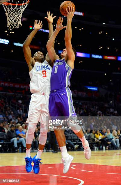 Bogdan Bogdanovic of the Sacramento Kings attempts a lay up against C J Williams of the Los Angeles Clippers on October 12 2017 at STAPLES Center in...