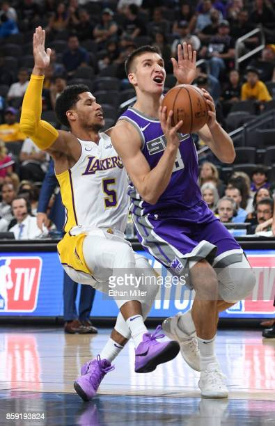 Bogdan Bogdanovic of the Sacramento Kings drives to the basket ahead of Josh Hart of the Los Angeles Lakers during their preseason game at TMobile...