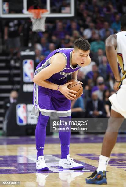 Bogdan Bogdanovic of the Sacramento Kings looks to make a move with the ball against the New Orleans Pelicans during an NBA basketball game at Golden...