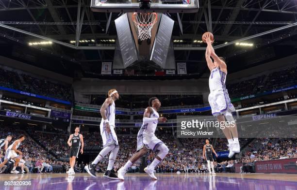 Bogdan Bogdanovic of the Sacramento Kings rebounds against the San Antonio Spurs on October 2 2017 at Golden 1 Center in Sacramento California NOTE...