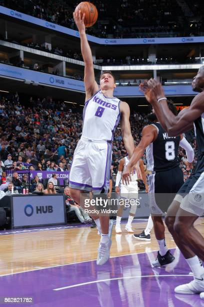 Bogdan Bogdanovic of the Sacramento Kings shoots a layup against the San Antonio Spurs on October 2 2017 at Golden 1 Center in Sacramento California...