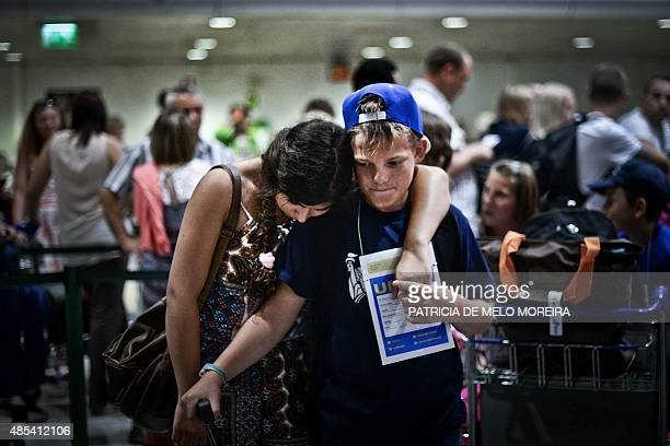 HAGEMANN Bogdan Nesterenko 9 years old waits to check in accompanied by a member of his host family at Lisbon's Airport on August 16 2015 Bogdan is a...