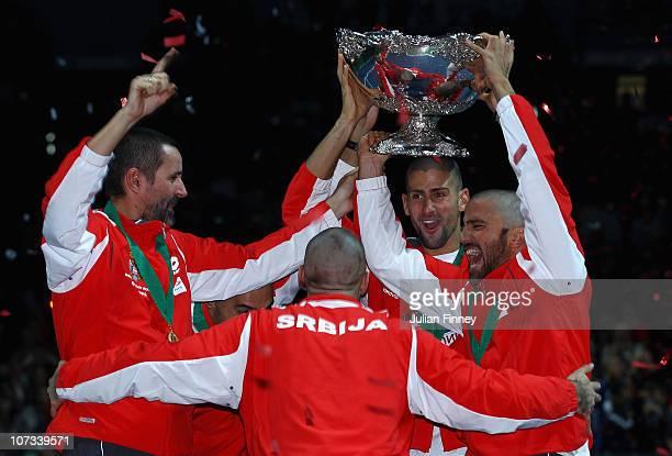 Bogdan Obradovic Nenad Zimonjic Novak Djokovic Janko Tipsarevic and Viktor Troicki of Serbia celebrate with the trophy after defeating France during...