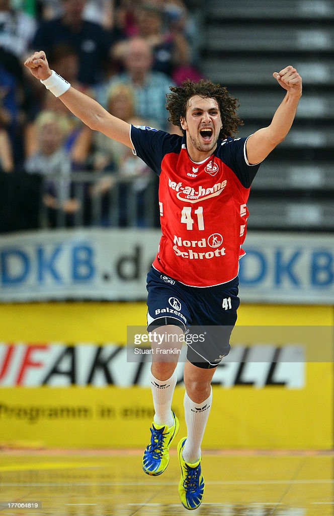 Bogdan Radivjevic of Flensburg celebrates scoring a goal during the DKB supercup match between THW Kiel and Flensburg Handewitt at the OVB arena on August 20, 2013 in Bremen, Germany.