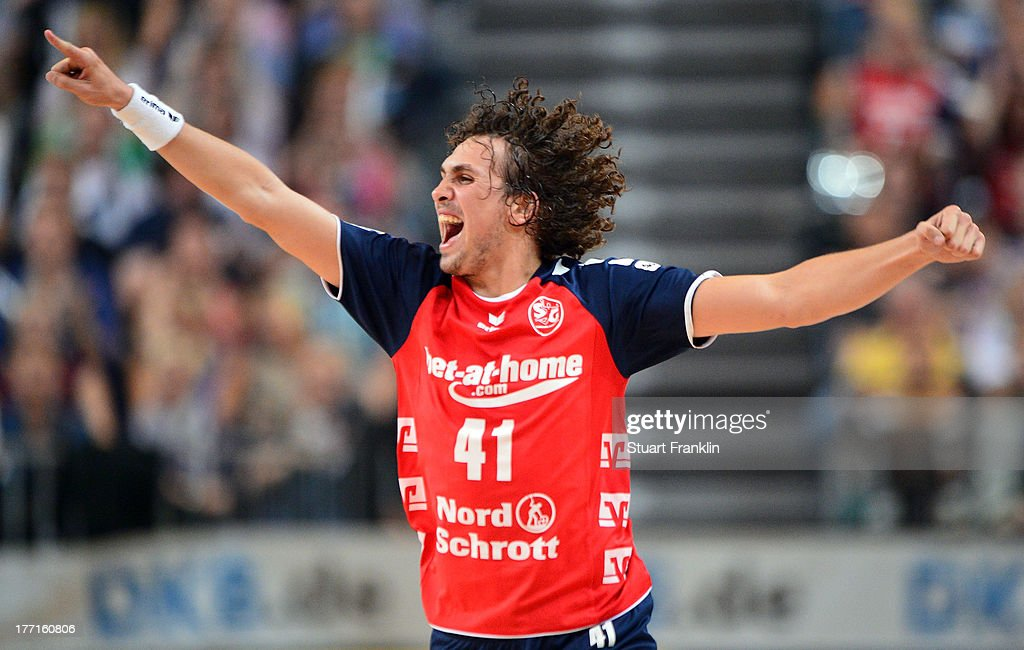 Bogdan Radivojevic of Flensburg celebrates during the DKB supercup match between THW Kiel and Flensburg Handewitt at the OVB arena on August 20, 2013 in Bremen, Germany.