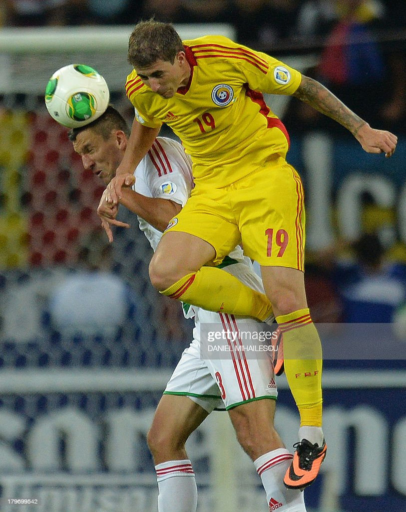Bogdan Sorin (R) of Romania vies for the ball with Hungary's player Vilmos Vanczak during the FIFA World Cup 2014 group D qualifying football match Romania vs Hungary on September 6, 2013 in Bucharest, Romania. Romania won 3-0.