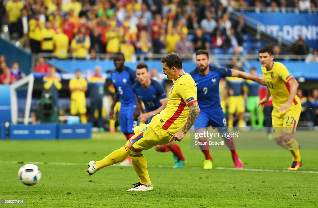 Bogdan Stancu of Romania converts the penalty to score his team's first goal during the UEFA Euro 2016 Group A match between France and Romania at Stade de France on June 10, 2016 in Paris, France.