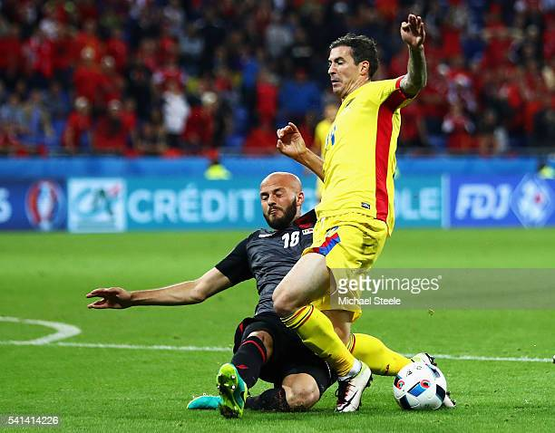 Bogdan Stancu of Romania is tackled by Arlind Ajeti of Albania during the UEFA EURO 2016 Group A match between Romania and Albania at Stade des...