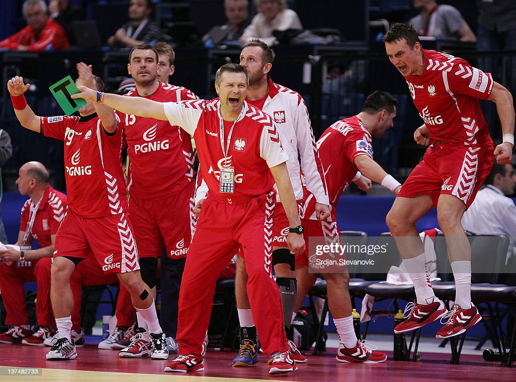 <a gi-track='captionPersonalityLinkClicked' href=/galleries/search?phrase=Bogdan+Wenta&family=editorial&specificpeople=453527 ng-click='$event.stopPropagation()'>Bogdan Wenta</a> coach (C) of Poland celebrates a goal during the Men's European Handball Championship 2012 group 1 match between Poland and Sweden at Belgrade Arena Hall on January 21, 2011 in Belgrade, Serbia.
