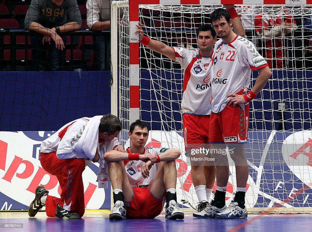 Bogdan Wenta head coach of Poland comforts Krysztof Lijewski after the Men's Handball European semi final match between Croatia and Poland at the...