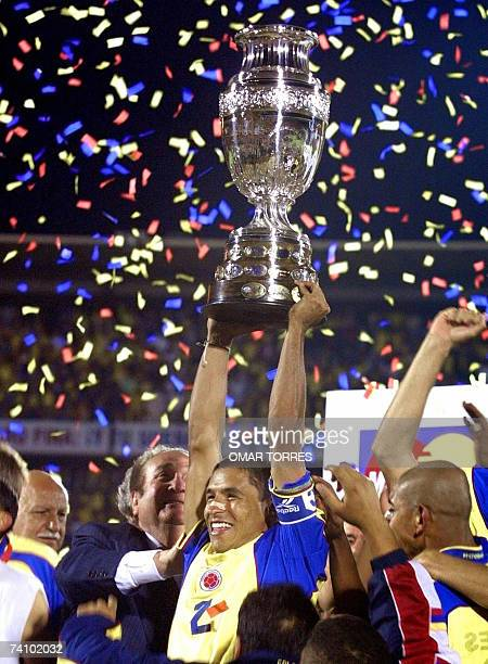 Colombia's goal scorer Ivan Cordoba holds the Copa America trophy 29 July 2001 Colombia defeated Mexico 10 in the final AFP PHOTO/Omar TORRES
