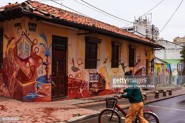 Bogota, Colombia - Cyclist and Street Art in La Candelaria