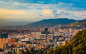 The Barrio de Usaquen viewed from the heights of La Calera in  the capital city of Bogota, Colombia in South America at sunset time.  The setting sun hits the buildings both tall and small at an obliq