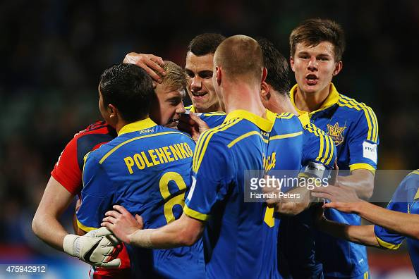 Bohdan Sarnavskyi of Ukraine celebrates with his team after saving a penalty goal during the FIFA U20 World Cup New Zealand 2015 Pool A match between...