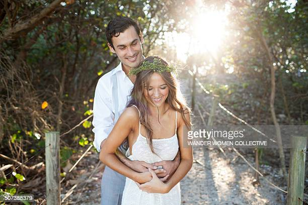Bohemian couple or bride and groom on beach