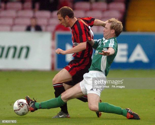 Bohemian FC's Aidan O'Keefe is tackled by Bray Wanderer's Stephen Giffens